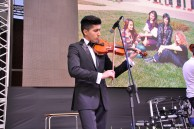 Master's degree student of the Chemistry Faculty Farid Mamedov playing the violin on the stage of Baku Branch of Lomonosov Moscow State University
